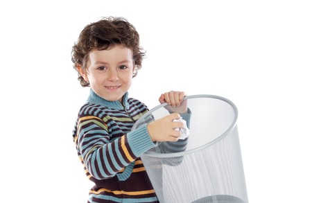 Boy with wastebasket over a white background photo