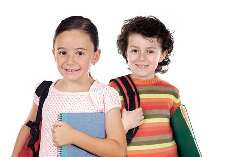 Two children students returning to school on a white background photo