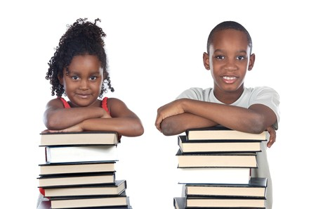 supported: Brothers supported on a stack of books isolated on white