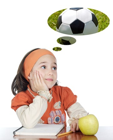 Adorable girl in class thinking about the ball a over white background photo