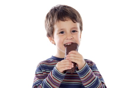 eating chocolate: Child eating a buns on a over white background