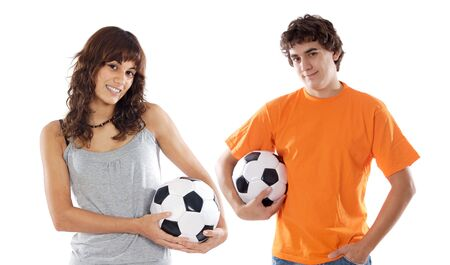 Couple of teenagers with soccer balls a over white background