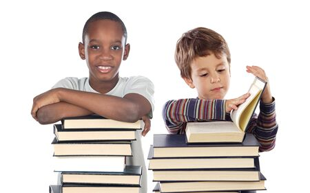 child couple: Adorable children with many books isolated over white