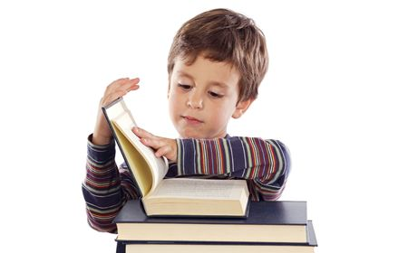Adorable child studying a over white background Stock Photo - 4665785