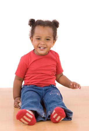 Adorable african baby sit over wooden floor photo
