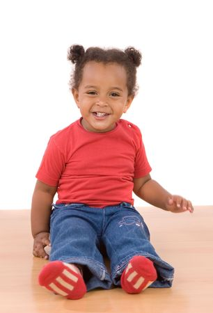 Adorable african baby sit over wooden floor Stock Photo