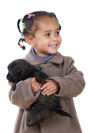 African baby holding a puppy on her arms isolated over white photo