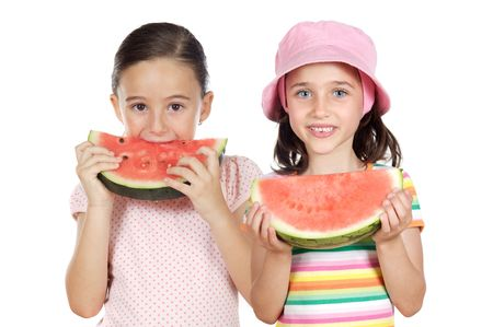 Two beautiful girls eating watermelon on a white background photo
