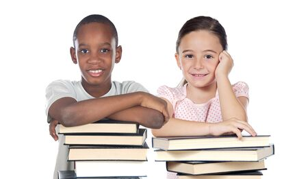 Two children supported on a stack of books isolated on white photo