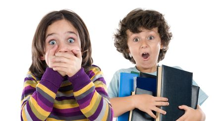 Surprised girl and a boy with many books falling isolated over white photo