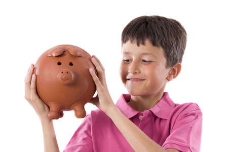 moneybox: Adorable child with moneybox isolated over white Stock Photo