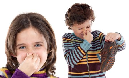 gesticulate: That smells bad! Two children covering the nose isolated on white. Stock Photo
