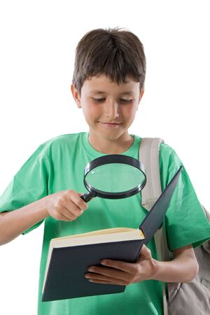 reading material: Smiling student reading with a magnifying glass Stock Photo