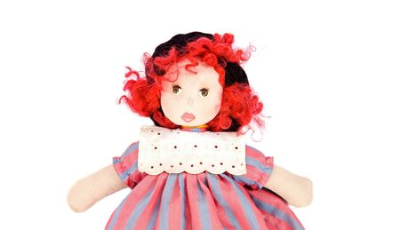 Beautiful rag doll on a white background photo