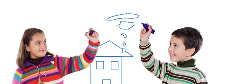 Two children drawing a house on a over white background photo