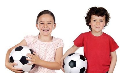 Two adorable children with soccer balls on a over white background photo