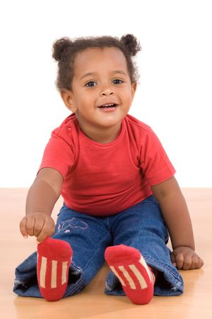 socks child: Adorable african baby sit over wooden floor Stock Photo
