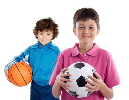 Two adorable children with balls on a over white background photo