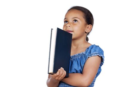 adorable girl studying with a book a over white background photo
