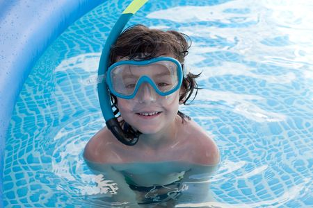 Child in the pool on holiday learning to swim photo