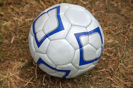 silvered: One silvered and blue soccer ball on the grass
