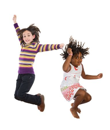 once: Two happy children jumping at once on a white background