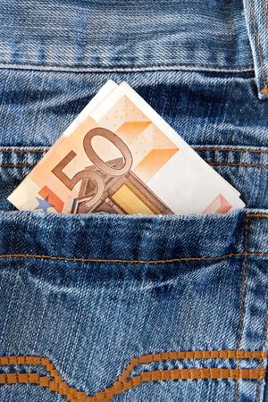 Pants jeans with money in the pocket photo