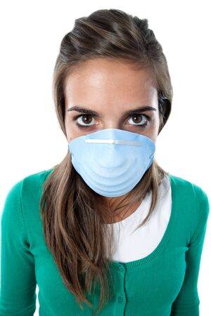 contagious: Distorted girl infected with influenza A and mask isolated over white Stock Photo