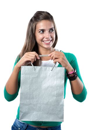 silvered: Pretty girl with silvered bag shopping on a over white background