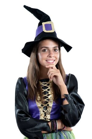 Thoughtful girl dressed in witch isolated on white background photo