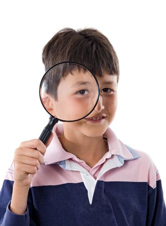 inquiring: Kid with magnifying glass a over white background