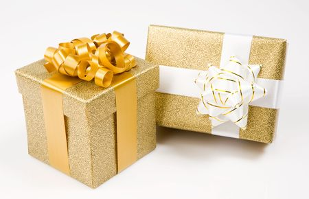 Beautiful golden gifts on a over white background photo