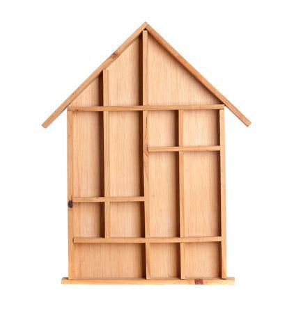 Symbolic wooden house isolated on white background photo