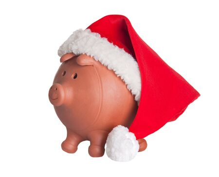 christmas budget: Piggy bank with Santa Claus hat isolated on white Stock Photo