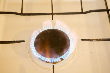 Photo of flames of kitchen oven burning gas photo