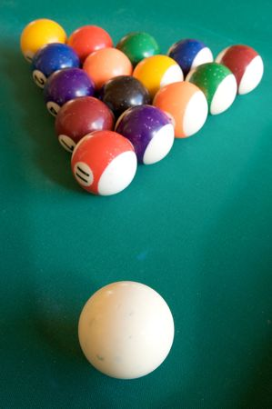 billiard-table with fifteen balls arranged as triangle photo