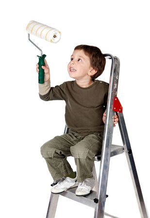 Adorable boy painting on a over white background photo