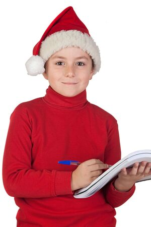Beautiful child writing his Christmas letter to Santa Claus photo