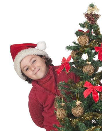 Beautiful child with Christmas trees isolated on white photo