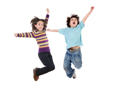 Two happy children jumping at once on a white background photo