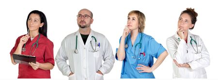 Medical team with pensive gesture isolated on a over white background photo