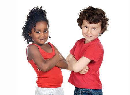 Two beautiful children of different races isolated on a over white background photo