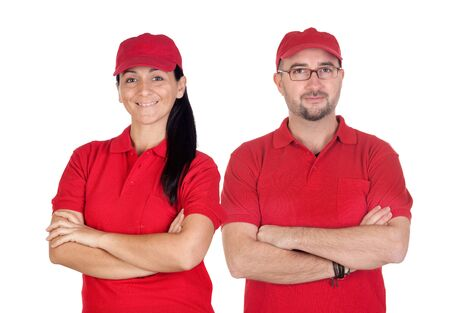 Deliverers team with red uniform isolated over white background photo