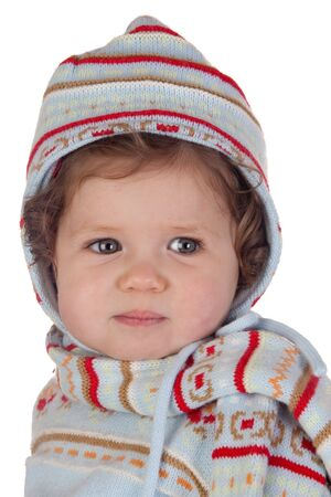 Funny baby girl with winter clothing isolated over white background photo