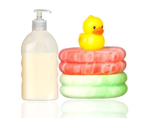 rubber ducky: Yellow plastic duck over sponges and boat bath dispenser isolated on a over white background Stock Photo