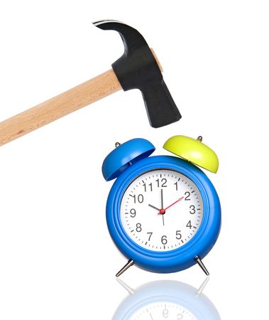 Clock and hammer a over white background photo