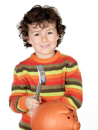 Adorable child with hammer and money box isolated on a over white background photo