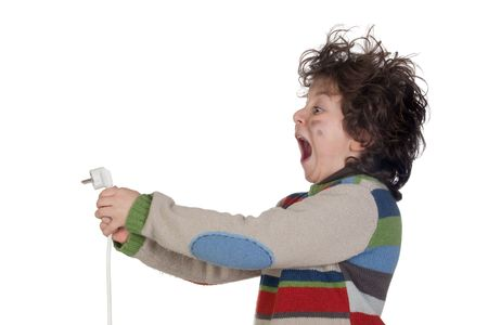 Child plug receiving electric shock isolated on white background photo