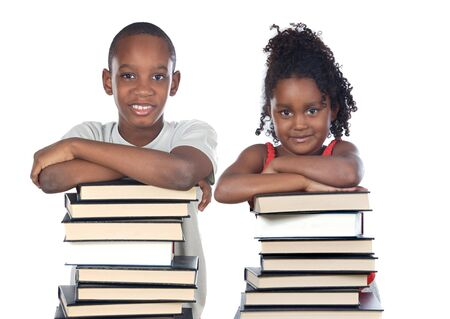 learning to read: Brothers supported on a stack of books isolated on white