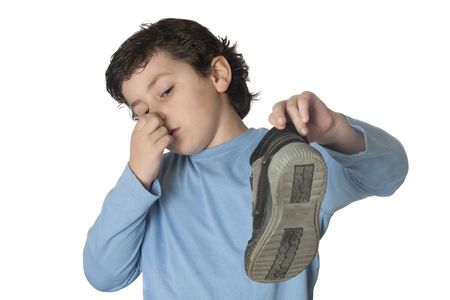 stinky: Child with a stuffy nose taking a boot isolated on white background Stock Photo